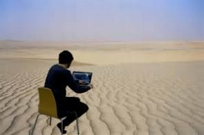 img man working alone in desert